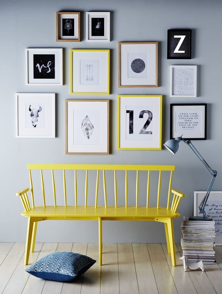 Gallery wall frames over yellow bench