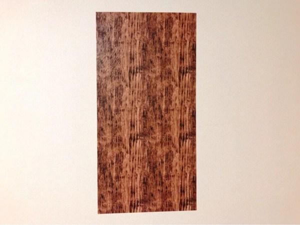 ダイソーの筒状のリメイクシート 木目アンティーク調を壁に貼ってみた