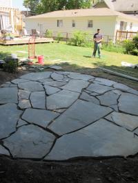 How to Install a Flagstone Patio with Irregular Stones ...
