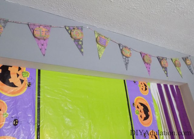 Let's get this DIY Halloween shindig back on the road! Find out how to make this super sweet DIY pumpkin banner for easy and beautiful party decor!