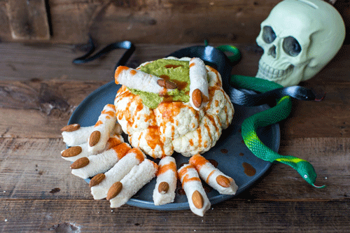 Throw the best zombie themed party in town with these easy and creepy DIY zombie party ideas! They all add up to a spectacularly spooky shindig!