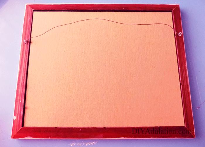 Cardboard backing inside of frame