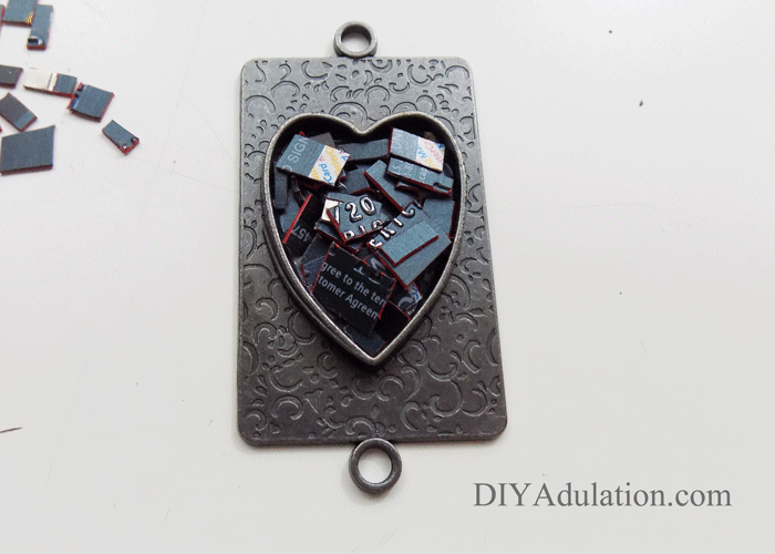 Cut up pieces of credit card inside heart pendant