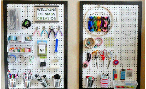 Giant framed pegboard with craft supplies organized on them