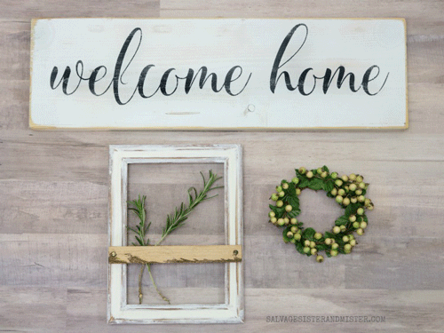 Wooden welcome home sign with farmhouse frame and green wreath below