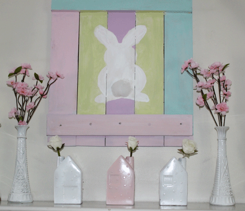 Pastel Bunny Pallet art on wall surrounded by vases with pink flowers