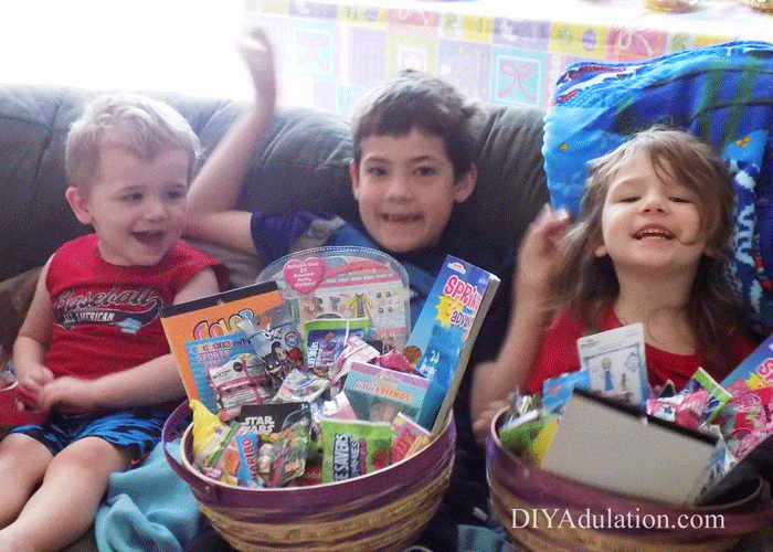 3 Kids sitting on a couch holding Easter Baskets