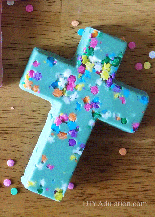 Green chocolate cross with sprinkles