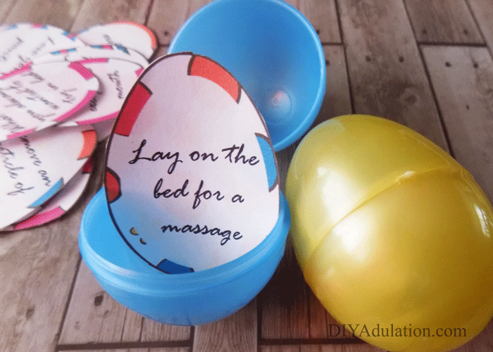 Close up of open plastic Easter Egg with paper date night activity inside