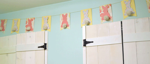 Hanging Easter Bunny Bunting on a wall