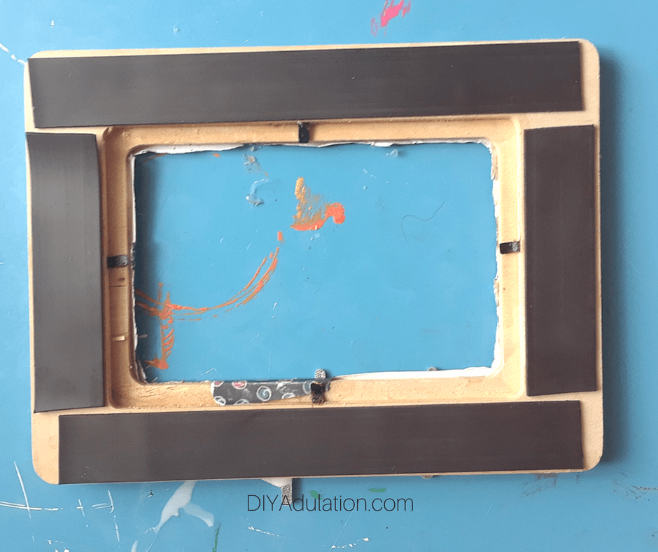 Strips of Magnet on the Back of a Wooden Frame