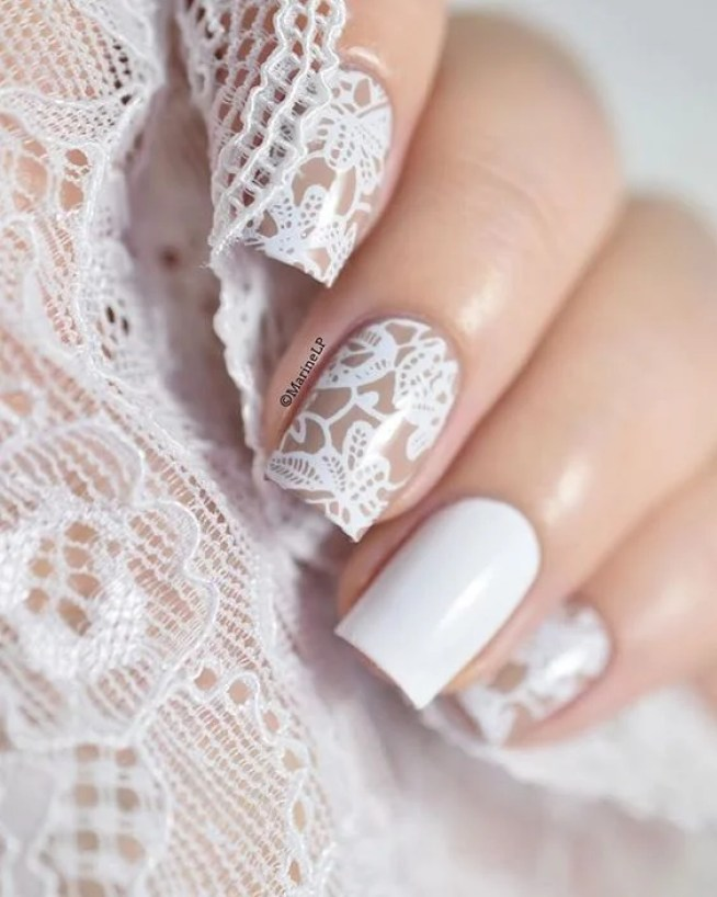 This beige and white lace nail design is so elegant! - 10 Artsy Lace Nail Designs To Copy - DIYbunker