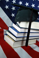 American flag with books and graduation