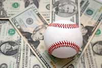 Baseball on top of money representing college baseball expenses