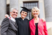 Parents with college grad representing how parents can help avoid student debt