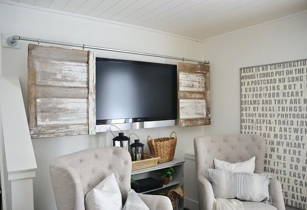 Cover Your TV In Style With This Sliding Barn Door DIY