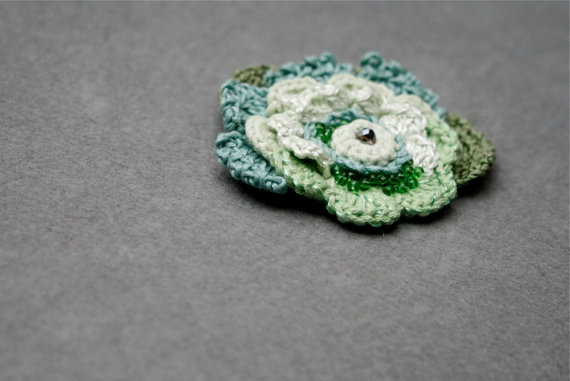 Freeform crochet brooch in shades of green by byMarianneS