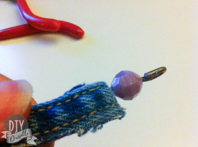 Used pliers to bend the ends of the bracelet, after adding the bead.