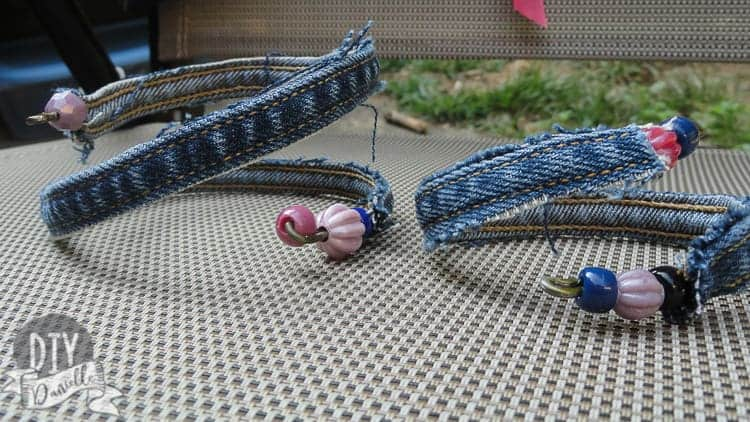 Two denim bracelets made with upcycled jeans and beads.