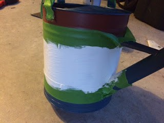 Adding a white stripe to the watering can to make it red, white and blue.