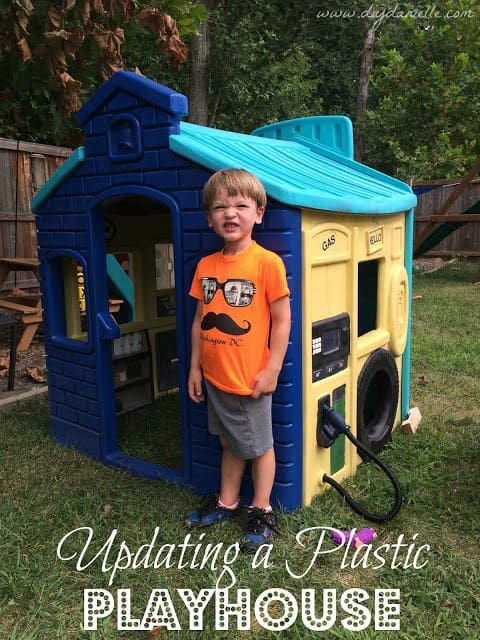 Painting a playhouse that is plastic.