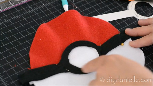 Adding black and white center to fabric Pokeball design.