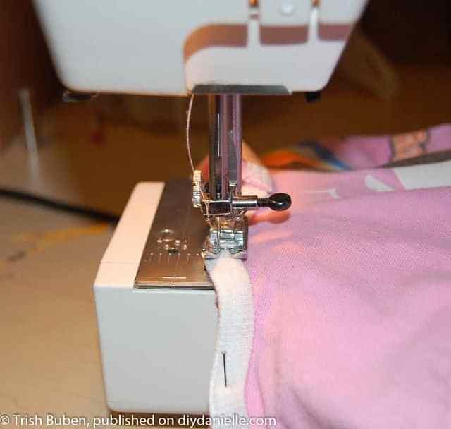 Binding being sewn on.