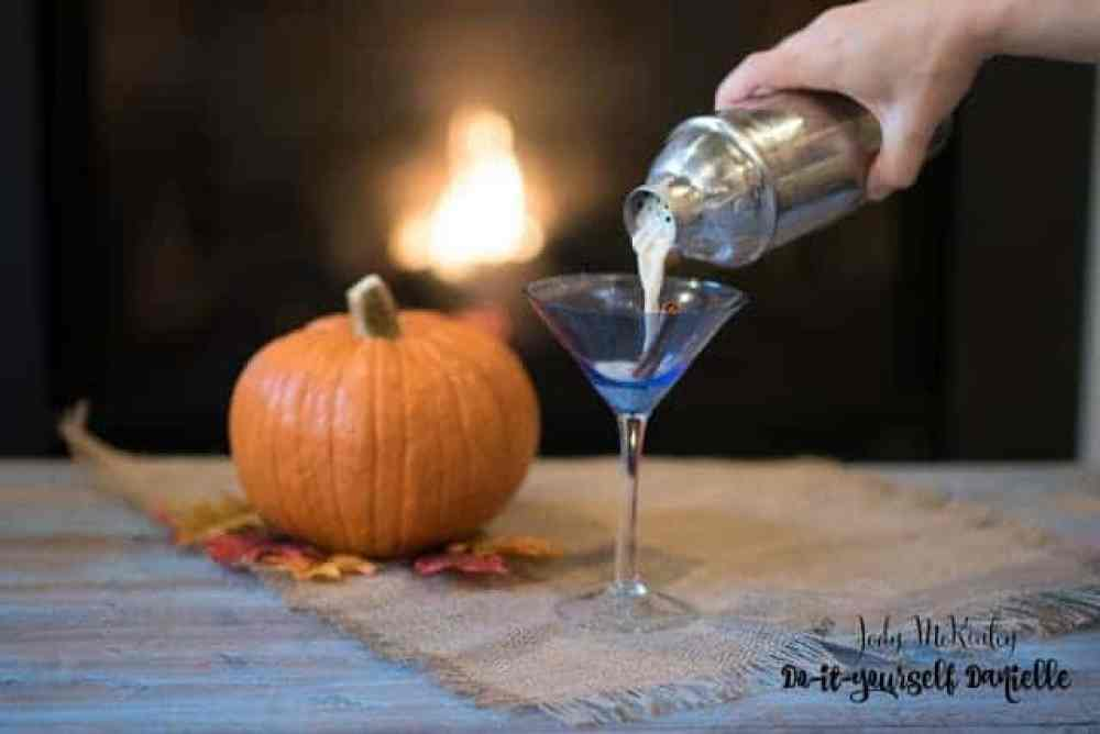 Pouring the pumpkin spice chata cocktail.