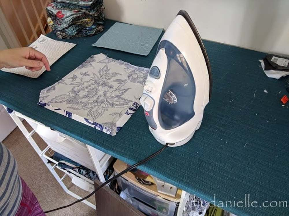 Ironing edges of the fabric.