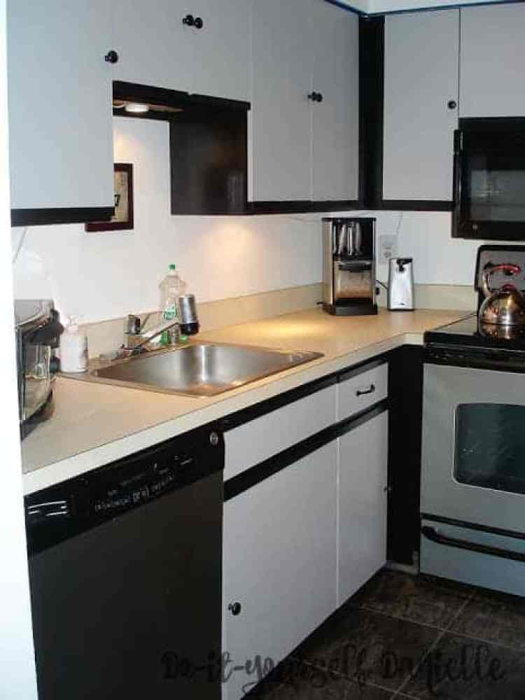 Updating a 1980's kitchen with laminate cabinets using paint.
