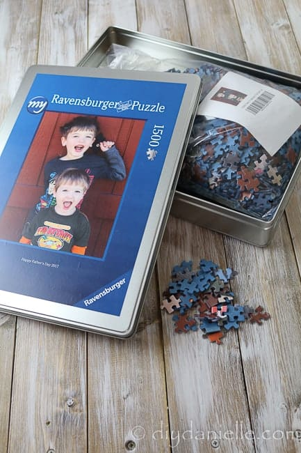 Quality photo puzzle from Ravensburger in a metal tin.