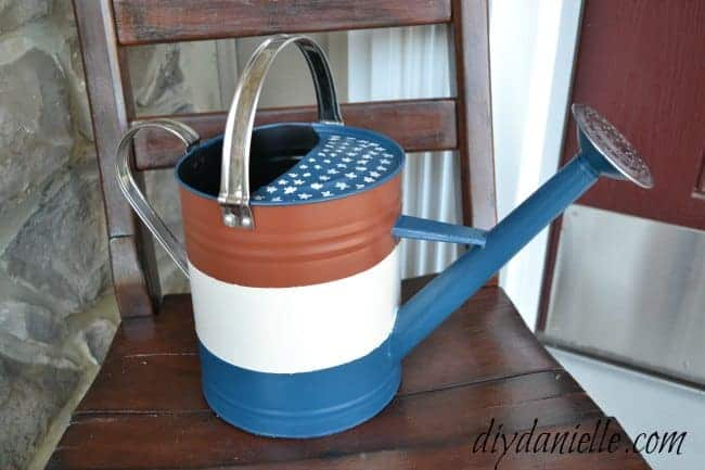 How to upcycle a watering can into a patriotic porch decoration.
