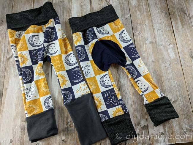 Grow with me pants: Maxaloones using dark bands and moon of my life custom fabric from a co-op.