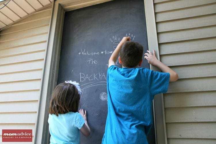 Using a door as an outdoor chalkboard.