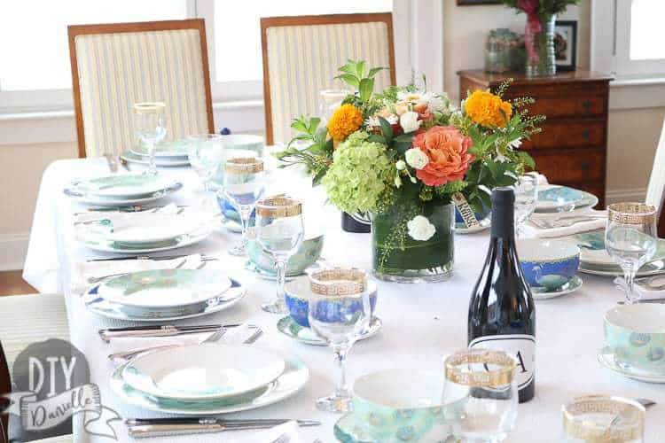 The table setup with peacock themed dishware.