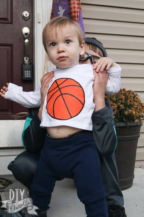 Baby as a basketball for Halloween. Easy shirt idea.