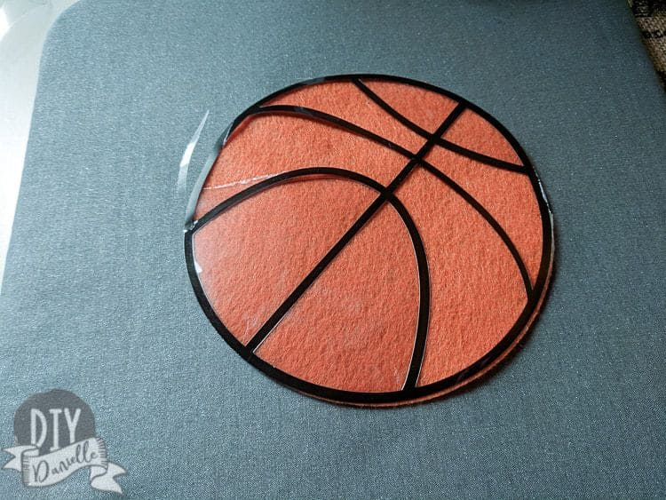 Using iron on and felt for a baby basketball shirt.