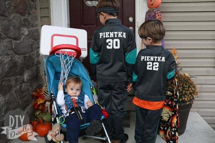 Basketball hoop over the stroller so baby is a basketball for Halloween.