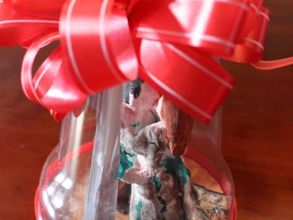 Kerstklok met mistletoe