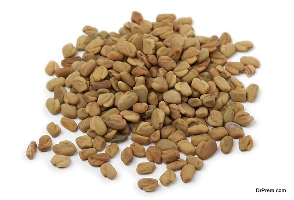 Heap of Fenugreek seeds on white background