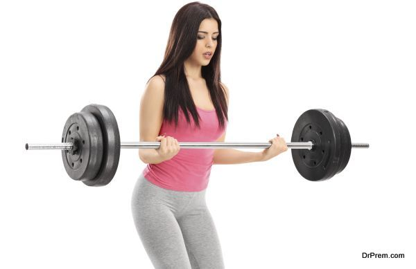 Attractive woman lifting a barbell