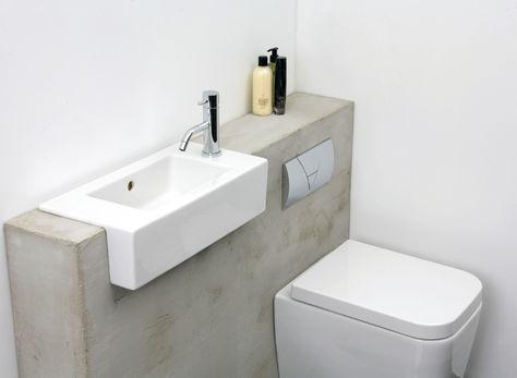Banheiro com revestimento de cimento queimado