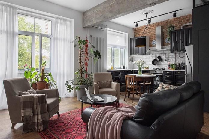 Apartamento urbano/industrial. Visão ampla da sala de estar integrada com a cozinha industrial