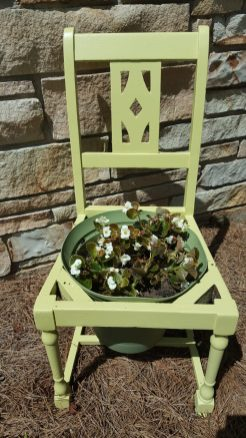 The white begonias are a perfect color to add to this chair turned planter.