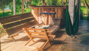 green hammock near wooden patio set aesthetic improvement