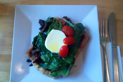 Mushroom, spinach, roasted pepper, tomato and chevre cheese on a waffle