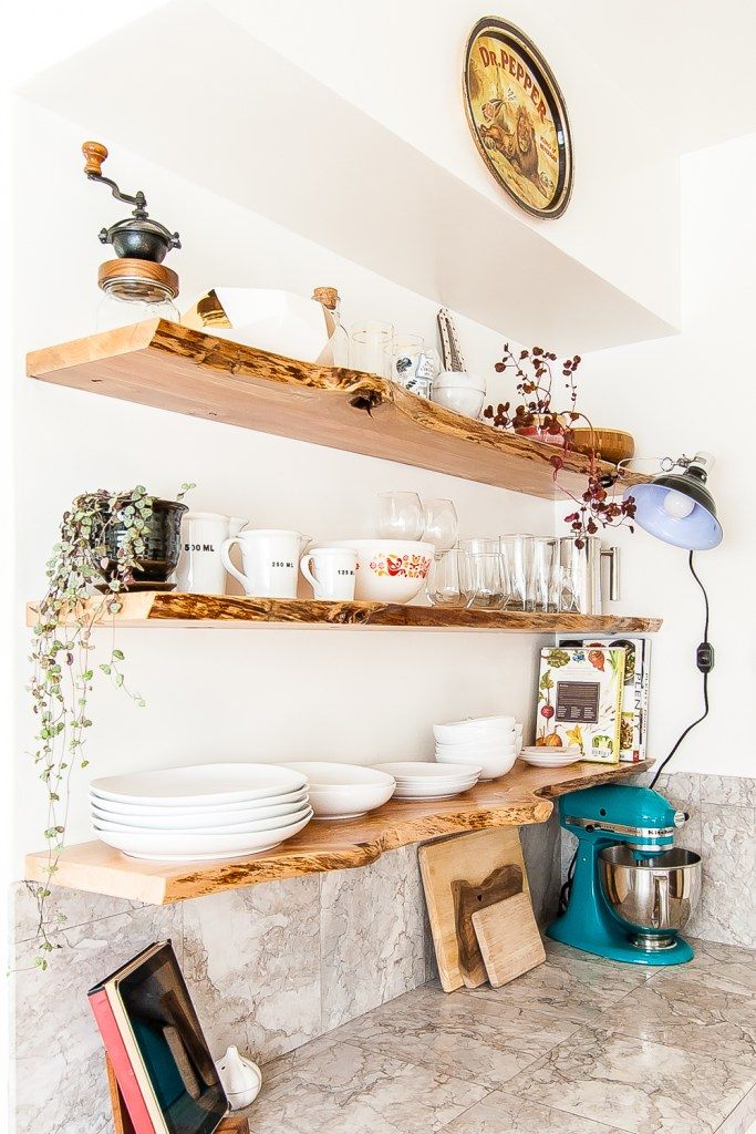 Kitchen makeover featuring white cabinets, and open shelving with live-edge floating shelves. #kitchen #openshelves #DIY #openshelving