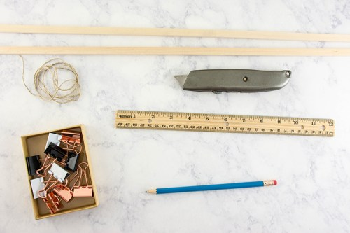 DIY your own inexpensive, simple wooden poster hanger, no power tools required.