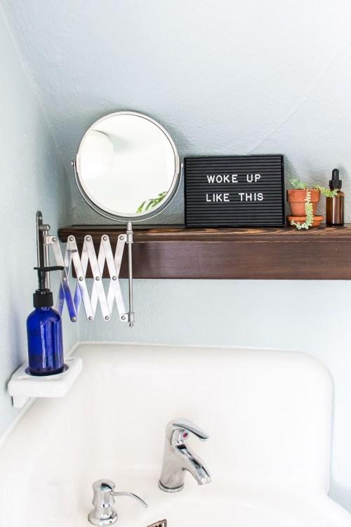 Bathroom Makeover: I installed a corner sink, built a reclaimed wood ledge shelf, and revamped a vintage medical cabinet.