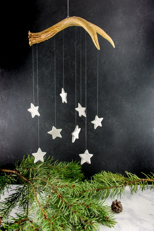 Make this Christmas star wall hanging with air dry clay, string, and an antler